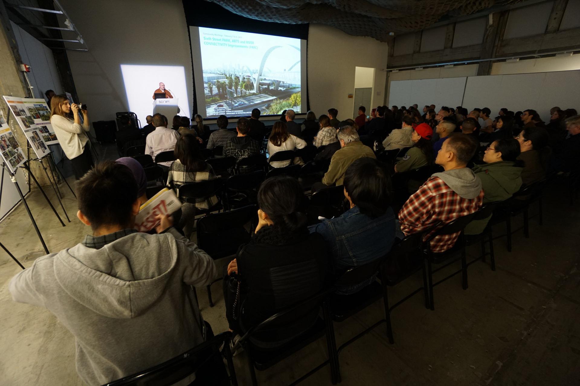 Photo of community members at a community meeting regarding the sixth street viaduct