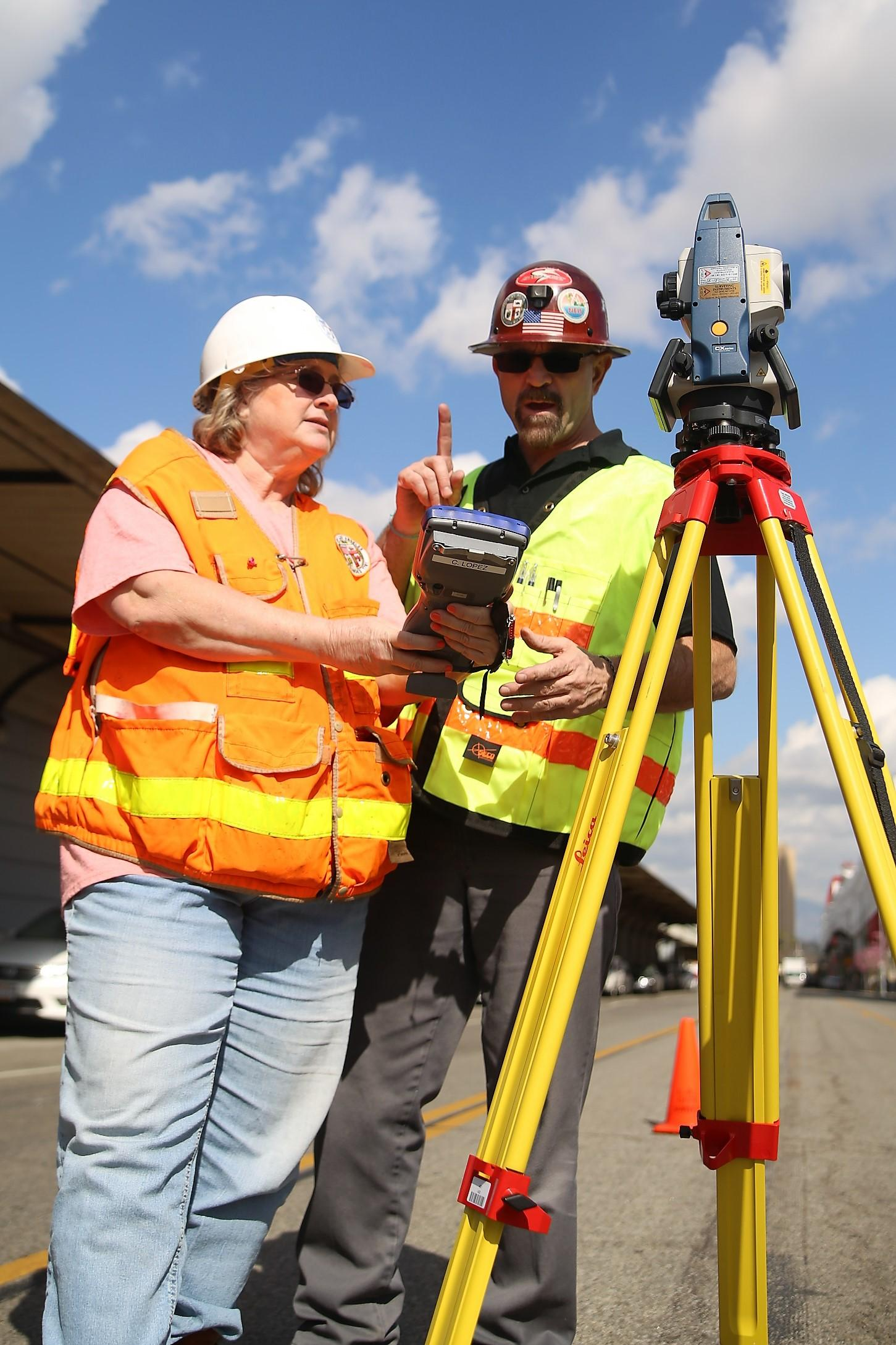 Picture of woman and man surveyors working on the field
